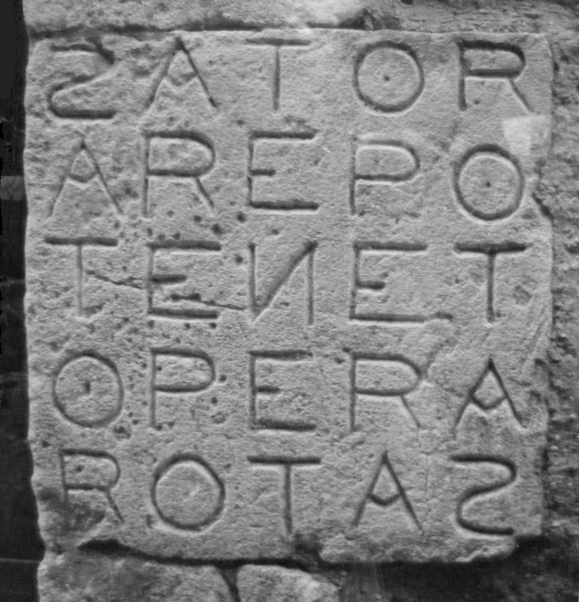 (A photograph of a rotas square inscription. The square consists of 25 letters arranged in a 5×5 grid, spelling out the words SATOR, AREPO, TENET, OPERA, and ROTAS on successive rows and columns.)